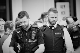 two Policemen viewing flowers in Manchester after the 2017 bomber
