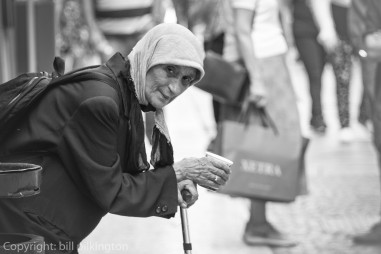 old lady begging on the streets of Verona