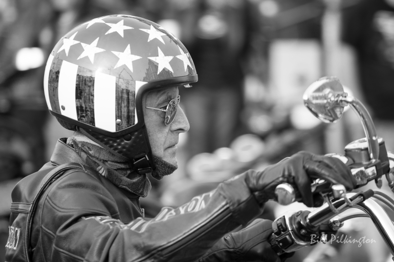 close up photo of a biker wearing a stars and stripes helmet