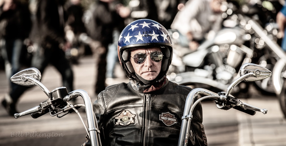 Born to be wild biker wearing open face, stars and stripes helmet