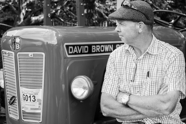 farmer leaning against David Brown tractor at the Todmorden agricultural show