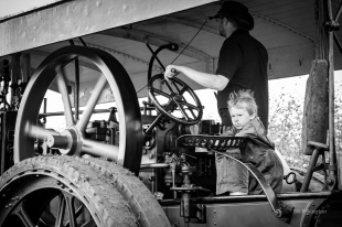 boy on at a steam traction rally