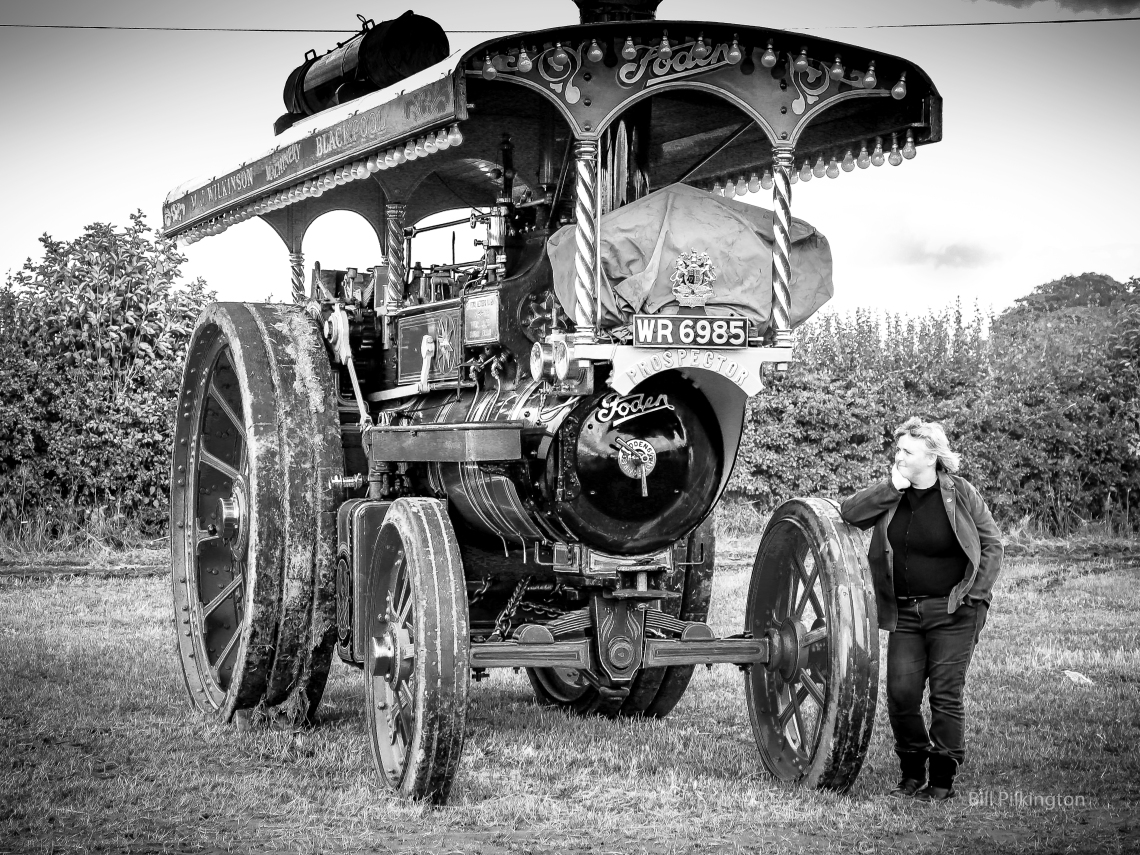 lady leaning on a steam traction engine