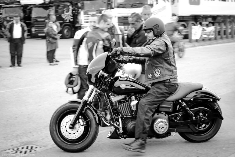 biker riding a black Harley Davidson.